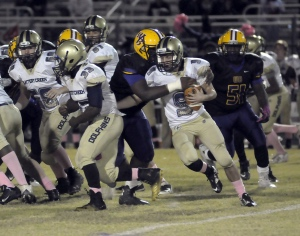Battery Creek's Porter Mahan gets wrapped up behind the line of scrimmage against Whale Branch