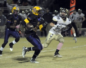 Battery Creek's Justin Cochran, right, closes in on Whale Branch's Stephon Eugene
