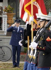 A U.S. Airman salutes Old Glory at the beginning of the annual Veterans Day parade.