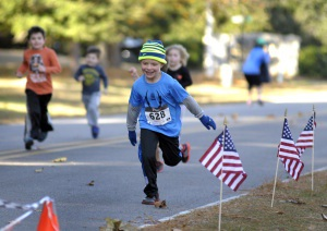 Children make a dash for the finish line, doing their part in raising money last Saturday for the fourth annual Island Charities.