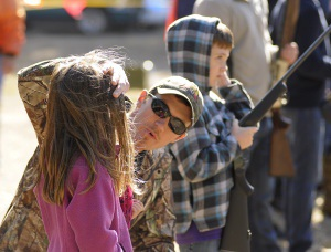 Kevin Averill, center, of Beaufort, checks his daughter Blythe, 7, for hearing protection before her brother Caden, 9, fires his .410 shotgun
