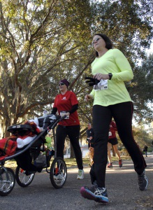 Runners and walkers with strollers begin the Island Charities 5K.