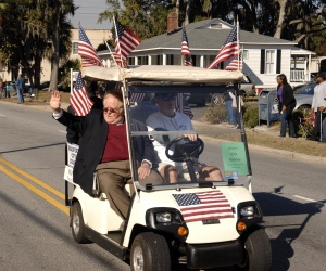 Beaufort Mayor Billy Keyserling waves to the crowd during the parade through downtown Beaufort.