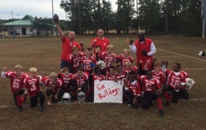 The Lady's Island Bulldogs PALS tackle football team for boys ages 7-8 won the championship game in double overtime against the Burton Wells Titans, 26-20, on Saturday, Nov. 8.