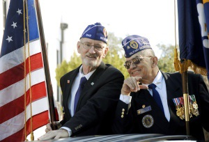 Two local veterans smile during last year's Veterans Day Parade in Beaufort. Photo by Bob Sofaly.