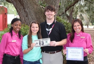 Winning Orthodontic Smiles presented Beaufort Middle School science teacher Derrick Mathis $100 for classroom supplies after student Caroline Robinson entered him in the Favorite Teacher Contest held by Dr. Skeet Burris and Dr. Travis Fiegle. Also pictured are Tiera White (left) and Sara Fauble (right) representing Winning Orthodontic Smiles. For more information, contact Emily Bowen at 843-525-6228.