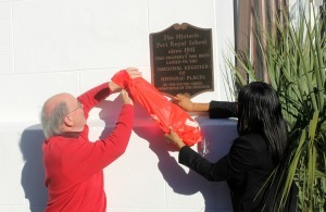 Historic Port Royal Foundation President Jim Crower (left) and Port Royal Elementary School Principal Chavon Brown uncover a plaque designating the school's historic status at ceremonies on Saturday, Dec. 13.