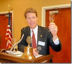 """In November, the Rotary Club of Beaufort celebrated 80 years of """"Service Above Self."""" Pictured above: President Sam leads the club in  a champagne toast to """"many more."""""""