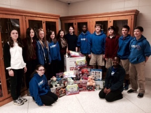 The National Junior Honor Society at Lady's Island Middle School recently held a toy drive to support the United States Marine Corps Reserve.  Those students pictured with some of the toys that were collected for this year's drive. A special thank you to Ms Lori Howell and Ms Kim Brown for helping this drive be a success this year. Back Row, from left: Taylor Maddox, Skye Pejsa, Nicole Marsh, Keara White, Amelia Evans, Sydney Maddox, Quentin Butler, Chase Guynup, Riley Kase, Max Kase, Jacob Denton. Front Row, from left: Sara Correll, Niquava Pope.