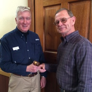 Dick Hoagland, left, director of Therapy Dogs International's Beaufort Chapter No. 229, passed the gavel to new Director Russ Dimke on Saturday.