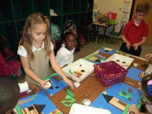 Art teacher Stephanie Riedmayer made Abe Lincoln log cabins with students in Mrs. Dangerfield's kindergarten class.  At Lady's Island Elementary students regularly integrate art into their academic lessons.