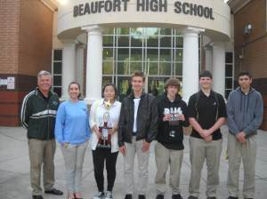 Pictured from left to right: Coach Doug Plank, Anna Kate D'Angelo, Jackie Kim, Lucas Cato, Chris Richardson, Deven Singleton, Casey Allen.