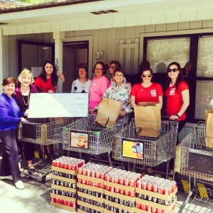 Pictured from left to right are Pam Rice of Our Lady's Pantry, Representative Shannon Erickson, Emilie Nicholls, Our Lady's Pantry volunteers and Coca-Cola staff (in red).