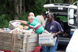 Letter carriers from the Burton and Charles St. Post Office work at the National Association's May 2014 food drive to help HELP fill food orders for individuals seeking assistance at their office.