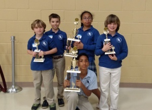 Pictured from left to right are Whit Suber, G. Simmons, Kendra Rogers, and Jack McDougall, with Kevin Rogers kneeling in front.