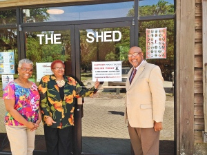 Floretta Glover and Theresa Jenkins, both volunteers, and Dr. Rodell Lawrence, new executive director of Penn Center encouraging museum visitors to give!