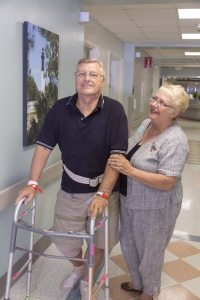 Beaufort Memorial Joint Replacement Center patient Wlodzimierz Zaryczny takes his first long walk, accompanied by his wife Theodora, after his recent knee replacement.