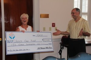 Jeneane Ryan presents check to Richard Blake, founder of Under One Roof.