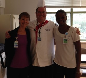 Chef Eric Sayers (pictured with hospital staff) gave a cooking lesson where he prepared three different dishes.