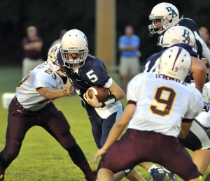 BA's quarterback scrambles to safety as he tries to gain yards.