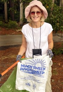 Lee Scott of the Dataw Island Garden Club begins her contribution to the Sweep near the Hunting Island Lagoon by picking trash.