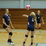 #2 Mary Hanna Hiers sets #8 Allison Suber for the kill. Photo courtesy of Michael Kaneshige.