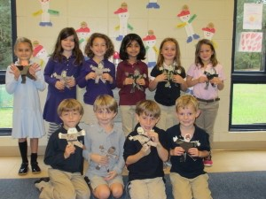Beaufort Academy 1st graders with representations of their veterans.