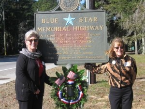 Sandie Duerksen, West Lowcountry District Director, Garden Club of South Carolina who placed the wreath with Donna Berger, President, Lady's Island Garden Club. Lady's Island Garden Club member, Anne Peters, made the wreath.