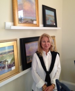 Eve Miller with some of her paintings.