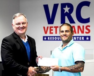 TCL President Richard Gough (left) presents TCL's first Veteran Scholarships Forever scholarship award to student Chris Kirby.
