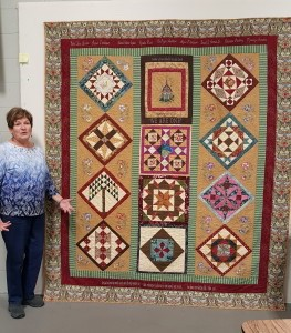 Nancy Metzger with her quilt, 'On the Road to Jericho'. Photo by Sharon Kimber.