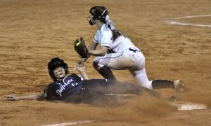 Battery Creek pinch runner Margaret Schubert gets tagged out at third base. Photo by Bob Sofaly.