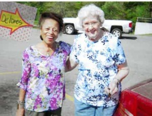 """Delores Nevils (left) at the Lady's Island Recycling Center/the """"Garbage Dump."""""""