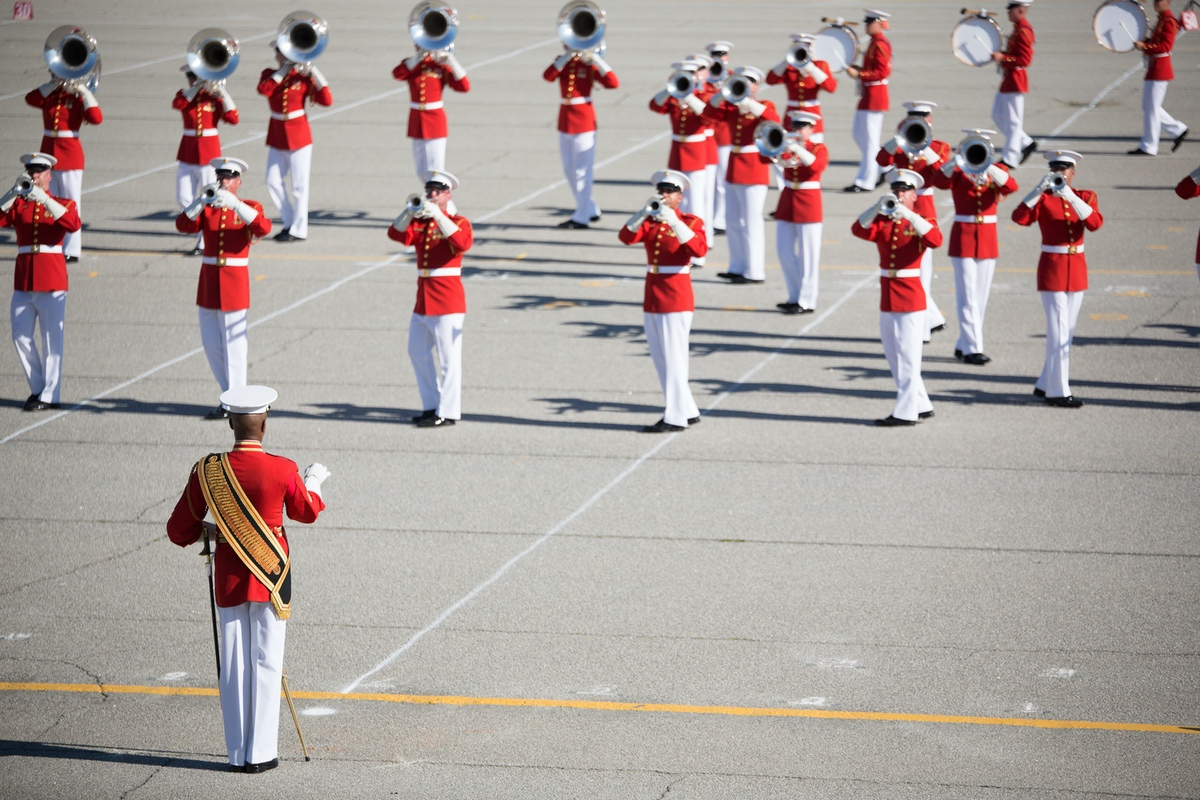 Marines with the U.S. Marine Drum and Bugle Corps march during a performance March 15, 2016, on Parris Island, S.C. The Marines played a variety of modern and traditional music before an audience of more than 1,000 recruits, Marines and civilians. The drum corps is part of the Battle Color Detachment, based at Marine Barracks Washington, D.C. The detachment travels across the nation and abroad providing ceremonial musical support and entertainment. The performance was part of the detachment's 2016 spring tour.  (Photos by Pfc. Carlin Warren)