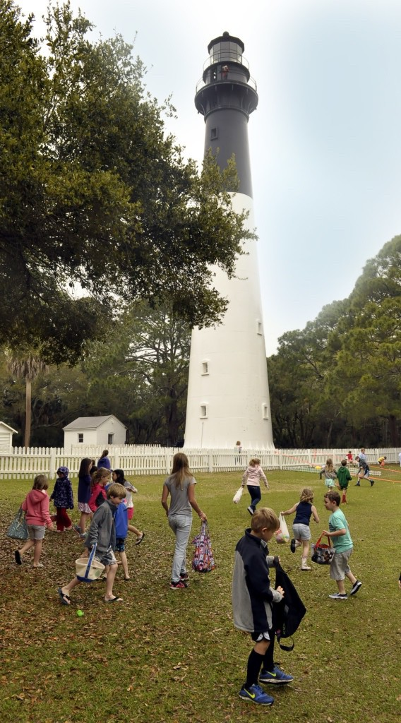 The rains held off as children looked for Easter eggs near the light house Saturday morning at Hunting Island State Park.