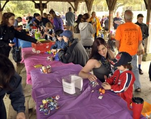 Amy Fisher helps her stepson, Nathan Vilasineekulis, open his plastic eggs.