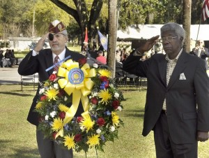 Ron Voegeli, left, and Morris Campbell salute after setting the floral wreath in at the Beaufort National Cemetery.