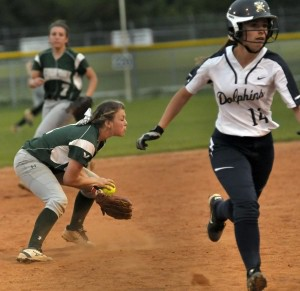 Savannah Mullen, left, shortstop for BHS, fields the ball as Battery Creek's Kyleigh Peeples sprints to third base. Photos by Bob Sofaly.