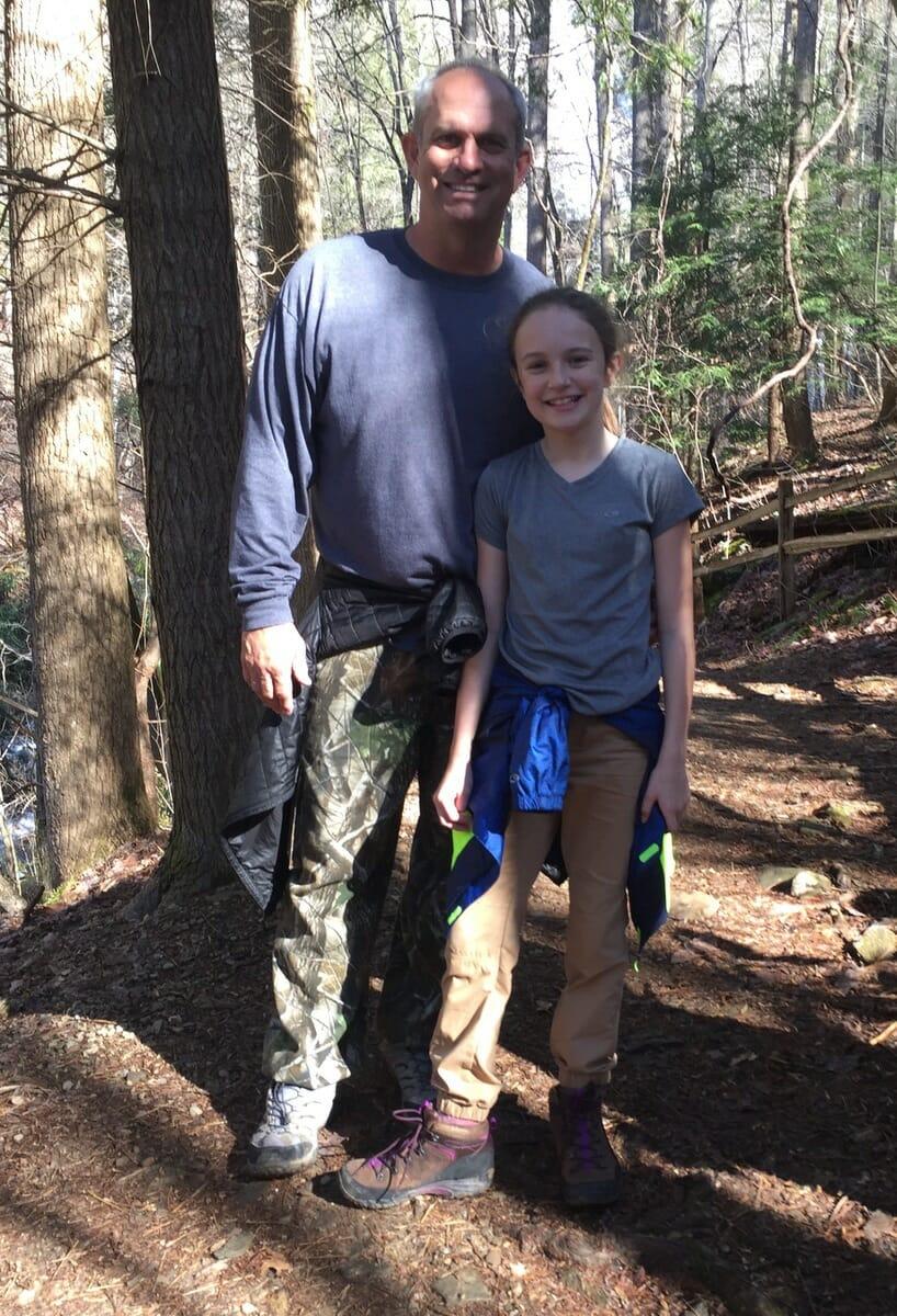 SCHOOLS Brycen Ambrose and her Chaperone Dad, Trey, enjoy a hike through Anna Ruby Falls during the Beaufort Academy's 5th  & 6th grade Interim Week field trip-
