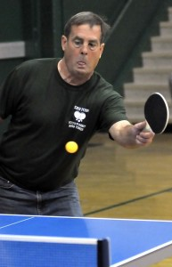 David Riedmayer, Beaufort High School varsity boys' tennis coach, returns the ball during the recent inaugural ping pong tournament to help raise money for the school's tennis team. Event organizers said the goal was to raise $1,500, which they did during the first two hours. Totals were not available at press time. Photo by Bob Sofaly.