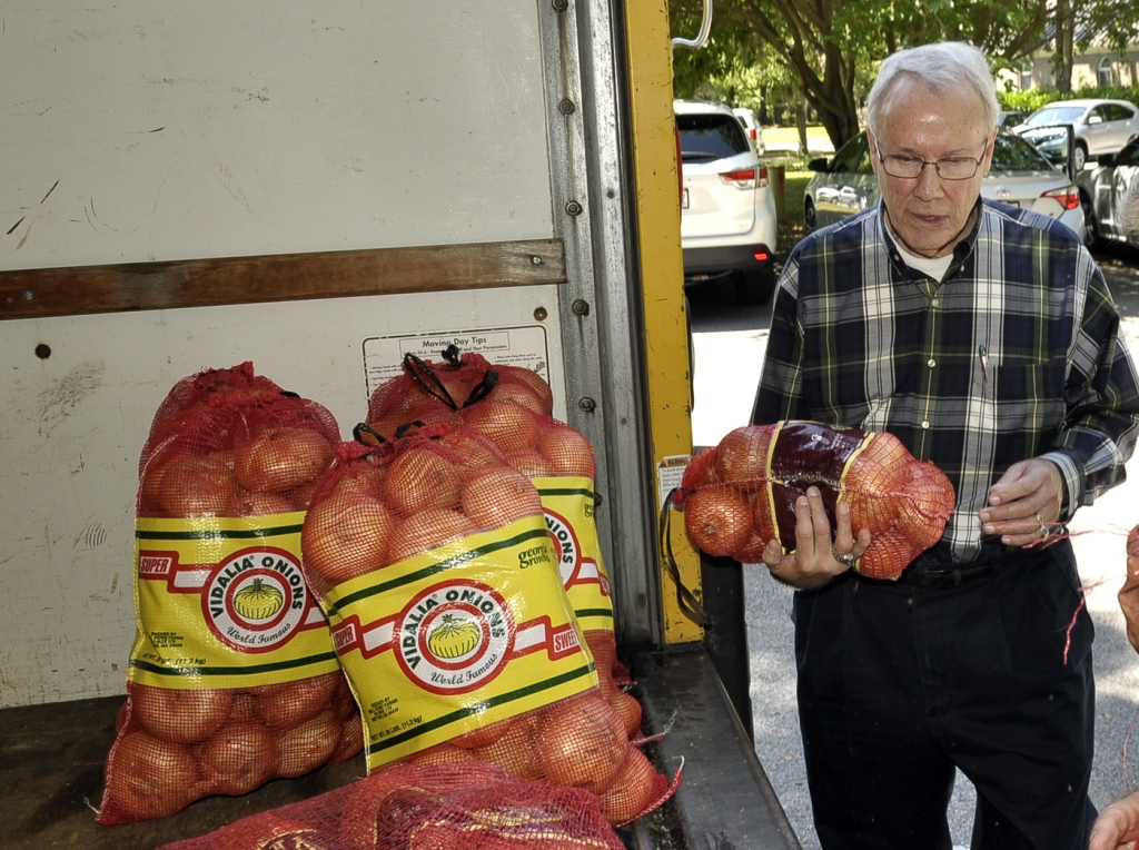 Nick Hunt of the Rotary Club of Beaufort waits for more 10-pound bags of onions. Onions can be purchased in either 10 or 25-pound bags.