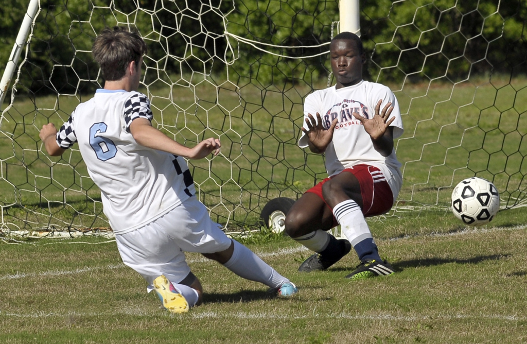 Beaufort Academy senior Cain Richards, makes the first goal against Bible Baptist Academy on Wednesday afternoon at Merritt Field.