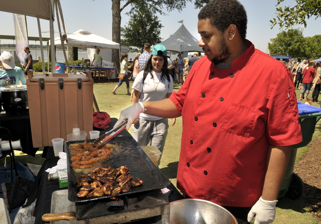 Jordin Rodriguez, right, of Emily's restaurant, cooks up some blackened shrimp, one of several seafood dishes available during the annual Taste of Beaufort.