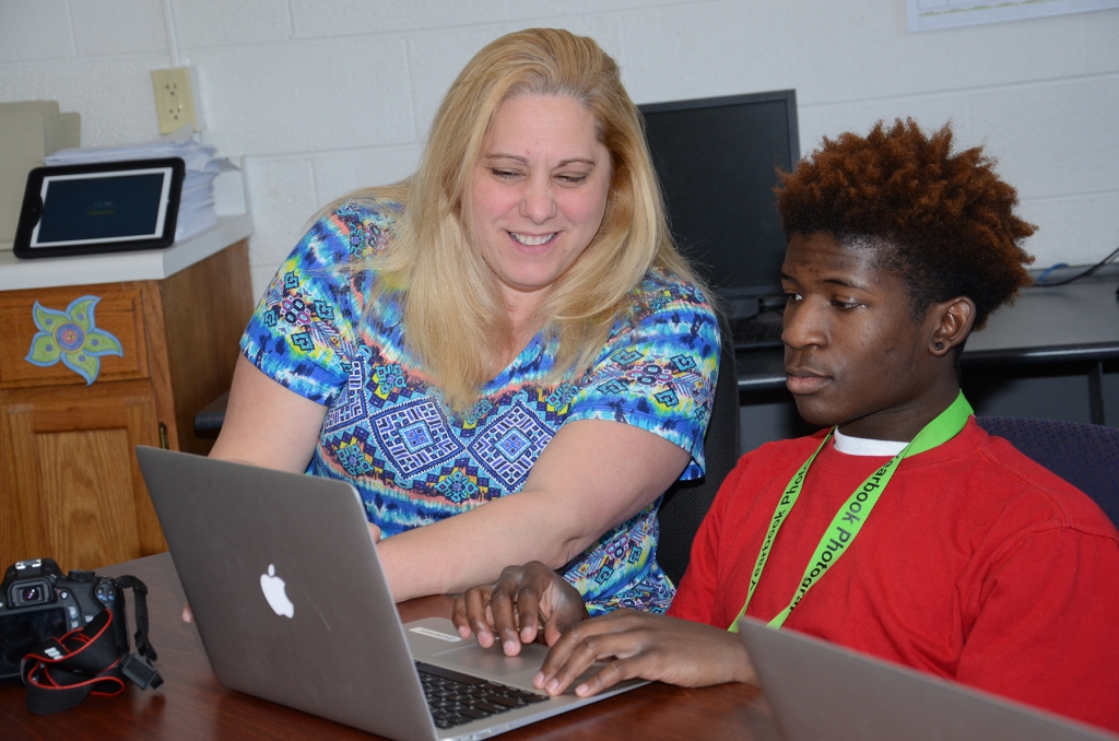 Devante´ works on the school yearbook with teacher Amy Sargent.