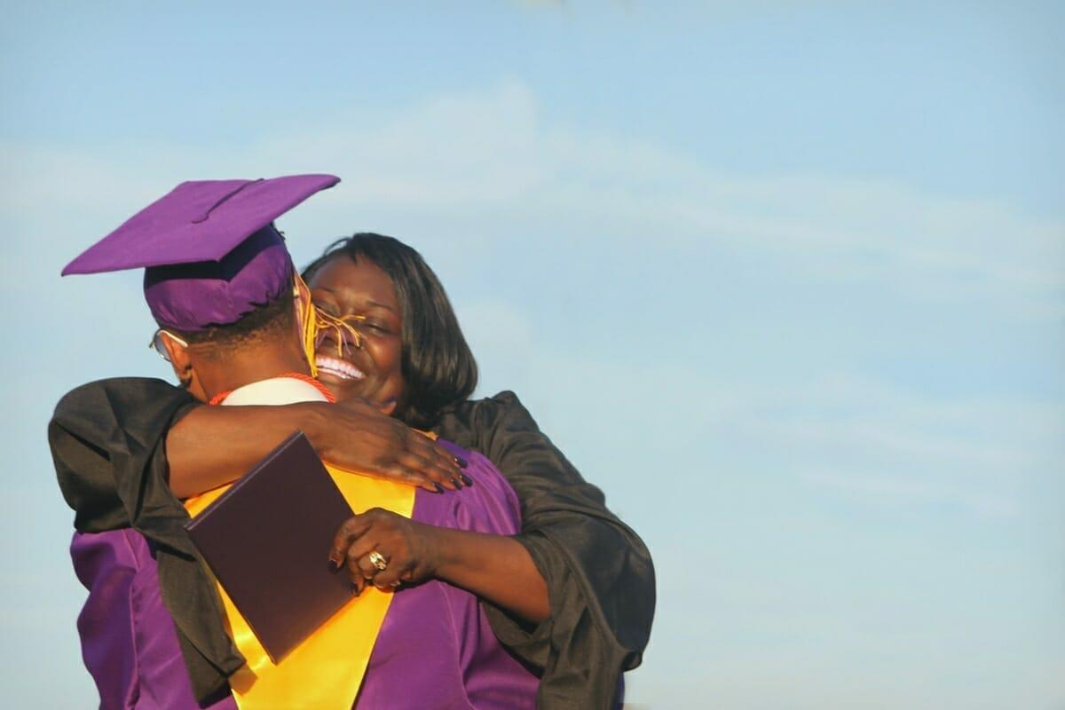 Whale Branch Principal, Mona Lise Dickson, hugs a graduate.