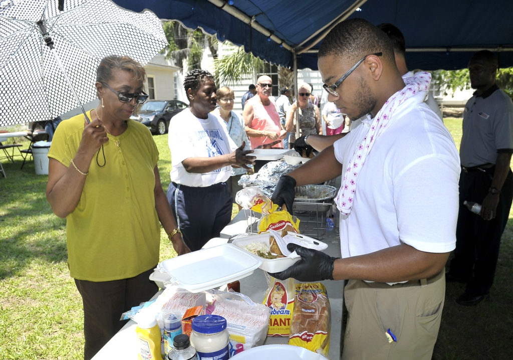 Maleek Ferguson, right, serves up the fried fish for Beatrice Washington at the 14th annual Fish Fry on Saturday, June 4, at the Sons of Beaufort Lodge 36.