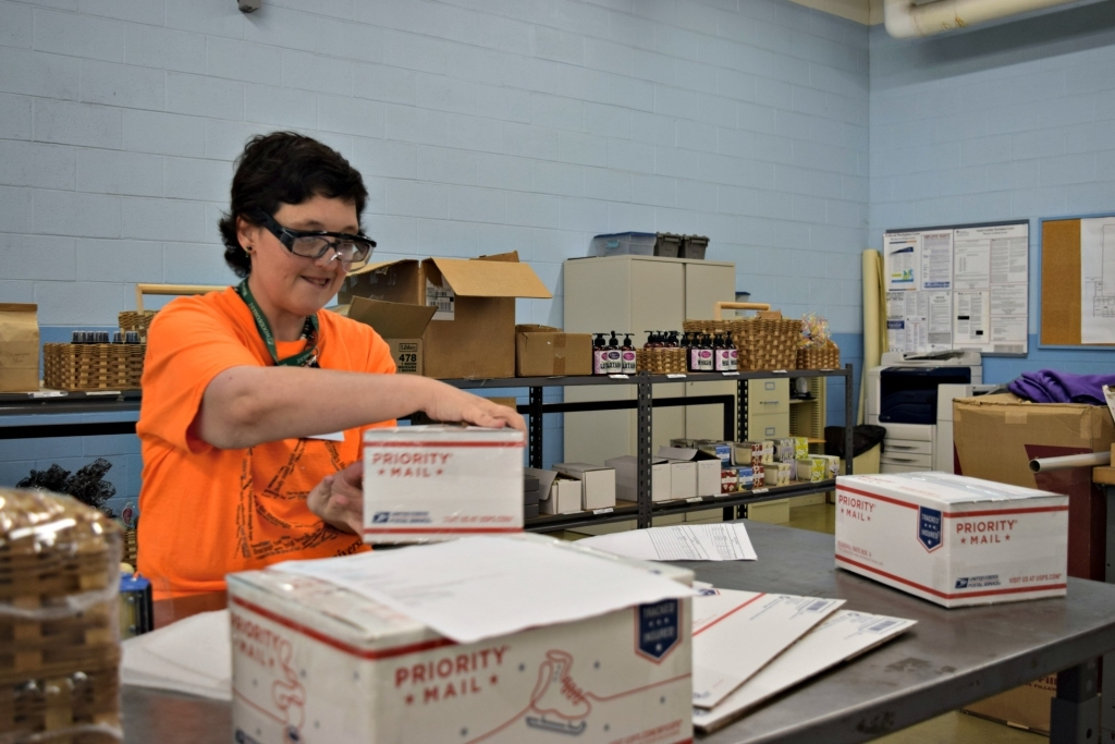Jennifer Murphy, a client of South Carolina Vocation Rehab Center, packages baskets for shipment.
