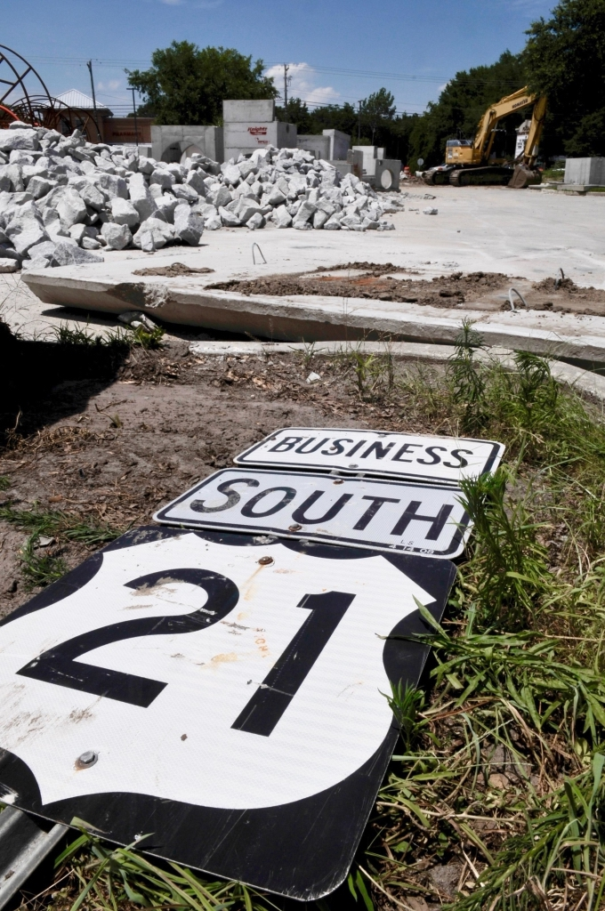 An old road sign lies with the rest of rubble in a holding yard at Boundary Street and S.C. 170 near Beaufort Plaza.
