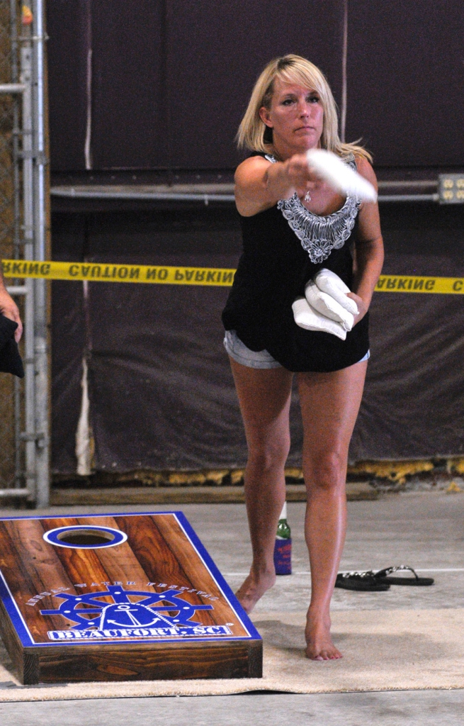 Tonya Morris takes aim and lets her beanbag fly during the annual Beaufort Water Festival cornhole tournament at The Shed in Port Royal.