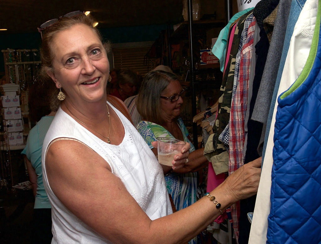 Susan Bishop looks through some of the many garments on display.